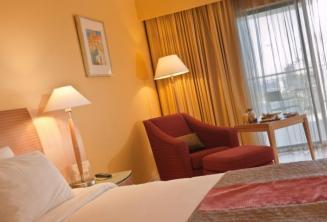 Een deluxe kamer in Le Meridien hotel, Malta